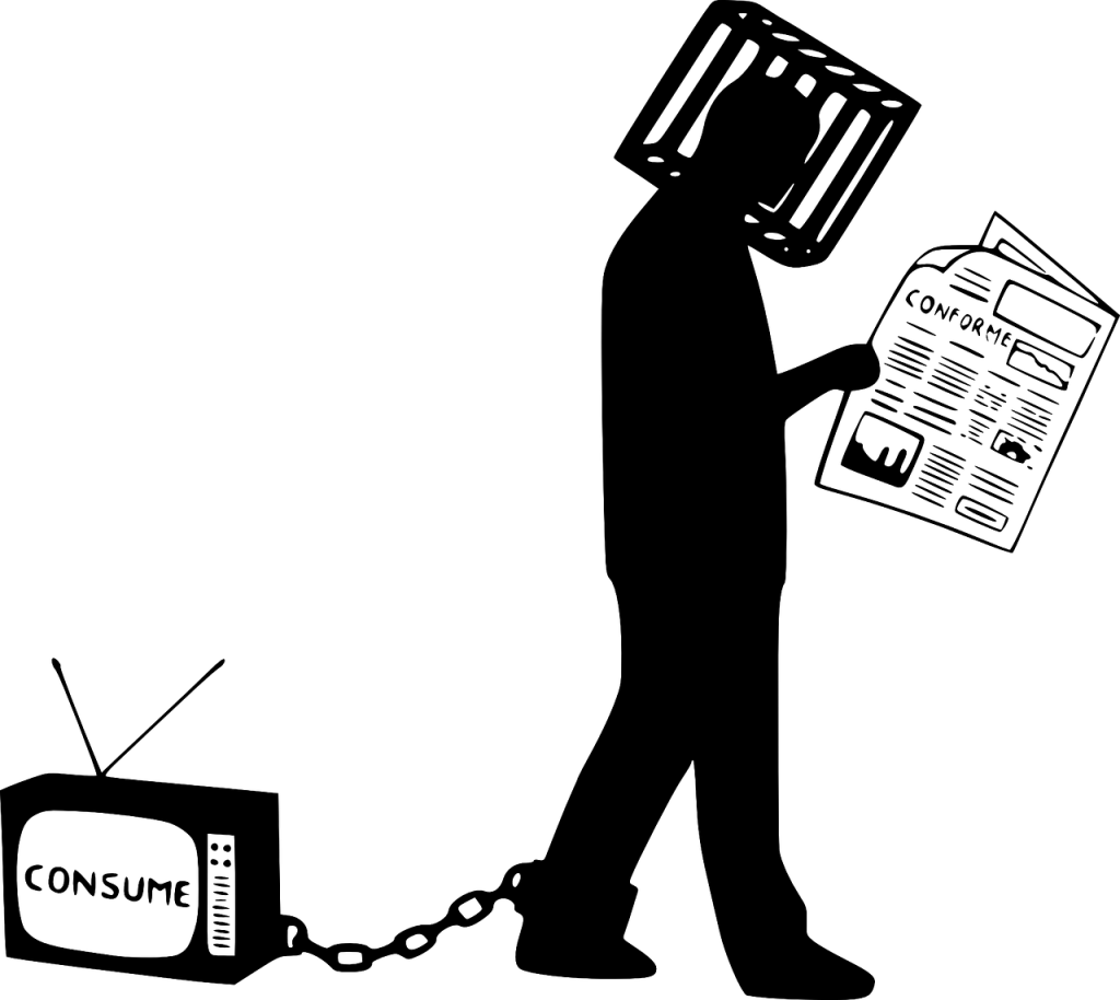 """A man is walking forward, reading a newspaper and not watching where he is going. There is a cage around his head. Hi has a ball and chain in his ankle but instead of the ball, there is a TV at the end of the chain. The TV-screen says """"Consume""""."""