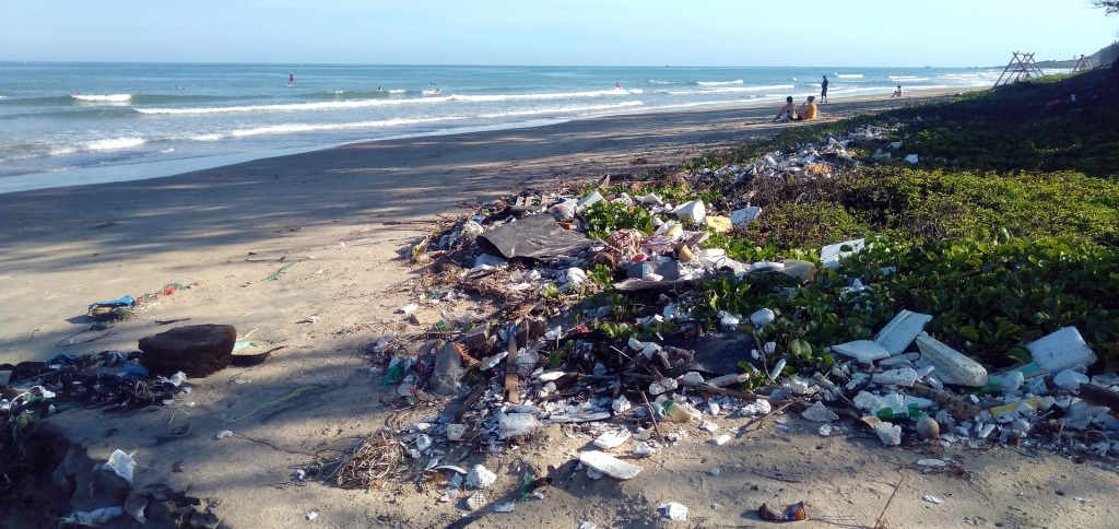 Plastic waste from the ocean has ended up to the beautiful beach.